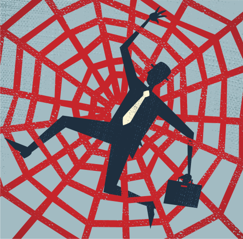 Businessman stuck in spiderweb